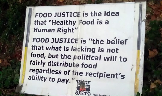 Photo of a sign  posted in a community garden in Oakland California
